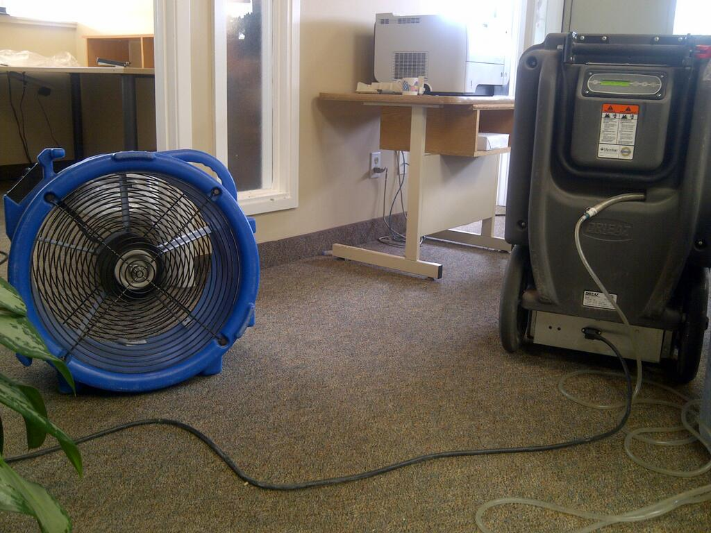 Large industrial fans and a de-humidifier to dry up the water