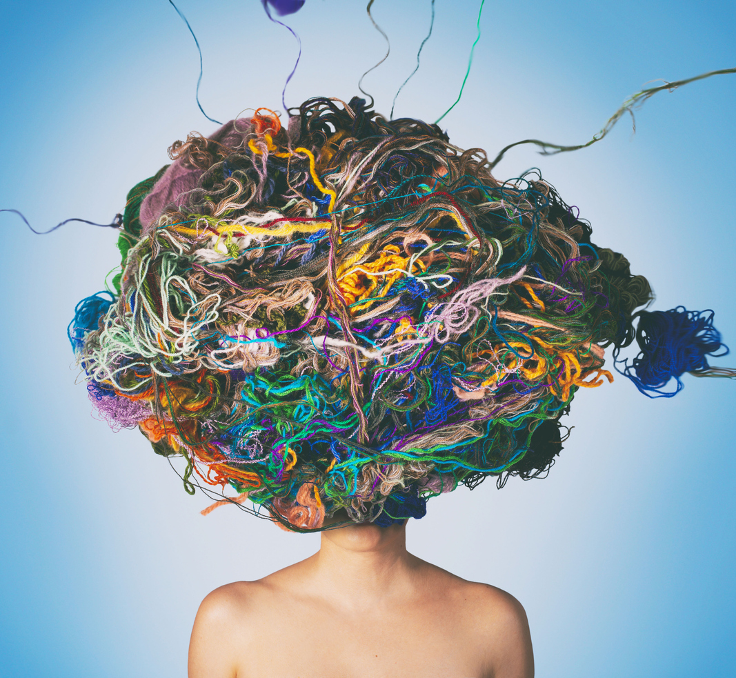Conceptual photo compilation of woman with tangled threads and wool on head. Tangled situation concept to show clutter.