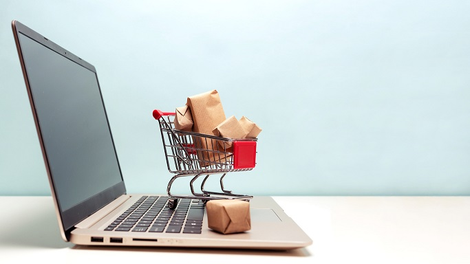 Shopping cart on a laptop to show online shopping