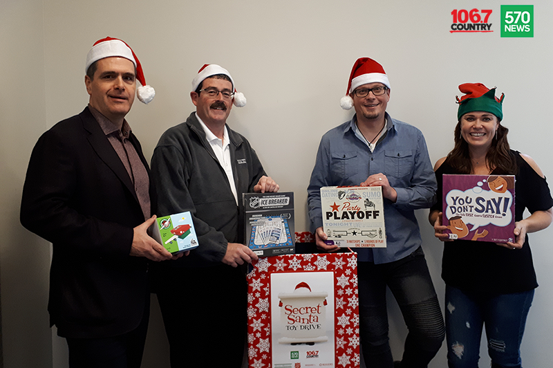 Doug Hoyes, Ted Michalos and 570 News radio crew posing for Secret Santa sponsorship