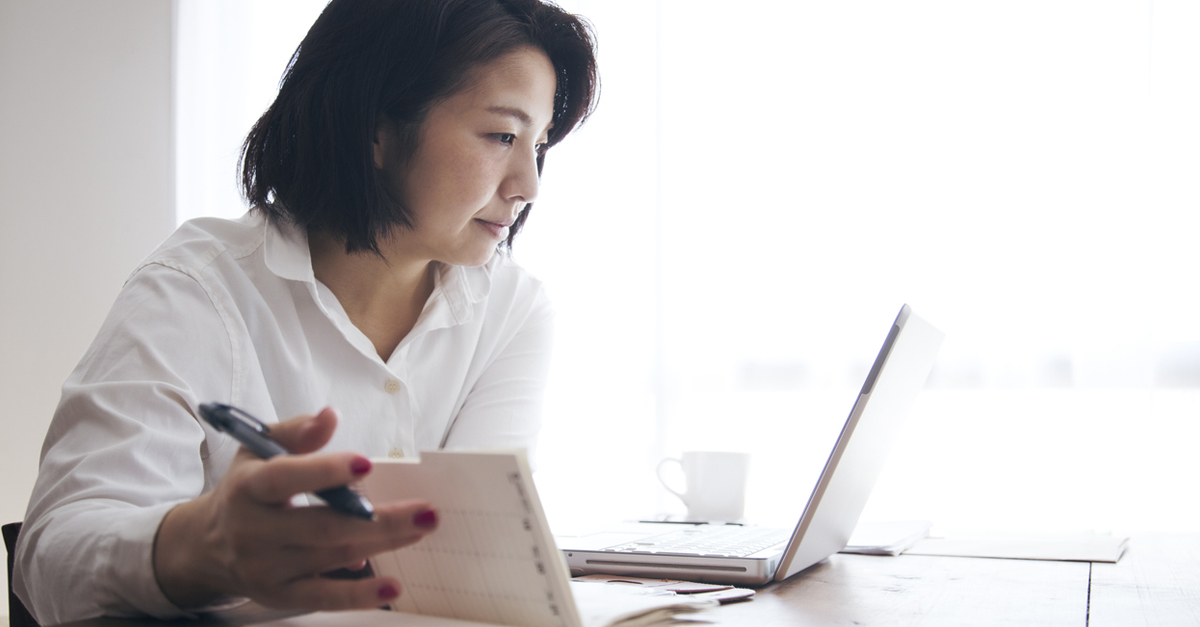 Woman working on personal finance at laptop